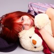 Beautiful girl sleeping with teddy bear - Foto Stock