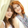 Stock Photo: Portrait of two beautiful girls at outdoor.