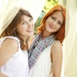 Portrait of two beautiful girls at outdoor. — Stock Photo #3463634
