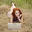 Young fashion girl with notebook lying at field — Stock Photo #3464071