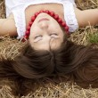 Beautiful girl lying at hay field. — Stock Photo #3464159
