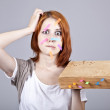 Red-haired student with book and notes on face. — Stock Photo #3464613