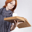 Young doubting fashion girl in glasses with old book — Stock Photo #3464819