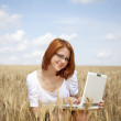 Young Businesswomen in white working with notebook at wheat fiel — Stock Photo #3464913