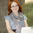 Young fashion girl in glasses and notebook sitting near — Stock Photo #3465050