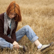 Royalty-Free Stock Photo: Lonely sad red-haired girl at field