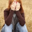 Lonely sad red-haired girl at field — Stock Photo #3465160