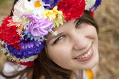 Slav girl with wreath at field — Stock Photo