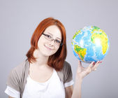 Young businesswomen with globe — Stock Photo