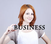 """Red-haired businesswoman show abstract word """"businiess'. — Stock Photo"""