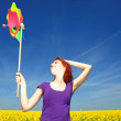 Young girl with wind turbine at rape field. — Stock Photo #3477408