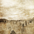 Cemetery in village. Photo in old image style. - Stock Photo