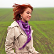 Girl at spring field - Foto Stock