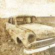 Old car at field. Photo in old image style. - Stockfoto