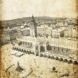 Main Market Square Cracow Poland. Photo in old image style. - Stock Photo