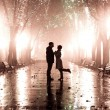 Couple walking at alley in night lights. Photo in vintage style. — Stock Photo