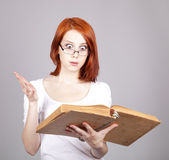 Red-haired smiling businesswoman keep book in hand. — Stock Photo