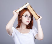 Red-haired businesswoman keep books in hands. — Стоковое фото