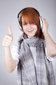 Girl with modern headphones show OK — Stock Photo