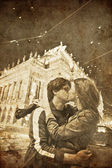 Two kissing in Praha, Czech Republic at night.Photo in old image style. — Stock Photo