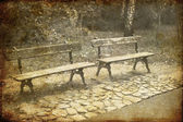 Two Park Benches. Photo in old image style — Stock Photo