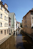 A small river flowing through the old town area of Prague, Czech Republic. — Stock Photo