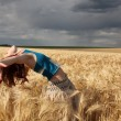 Beautiful girl at wheat field in rainy day — Stock Photo