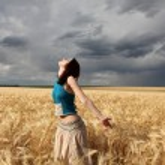 Beautiful girl at wheat field in rainy day — Stock Photo #3569334