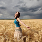 Beautiful girl at wheat field in rainy day — Stock Photo #3569335
