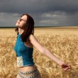 Beautiful girl at wheat field in rainy day — Stock Photo #3569339