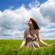 Beautiful young girl at green field — Stock Photo #3583859