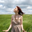 Beautiful young girl at green field — Stock Photo #3583866