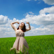 Beautiful young girl at green field — Stock Photo #3583948