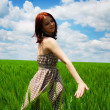 Beautiful young girl at green field — Stock Photo #3583950