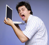 Angry boy with white notebook. Studios photo. — Stock Photo
