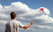 Boy play with fly kite — Stock Photo