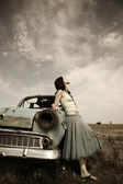 Girl near old car, photo in vintage style — Stock Photo
