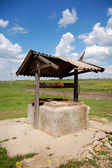 Old well in village — Stock Photo