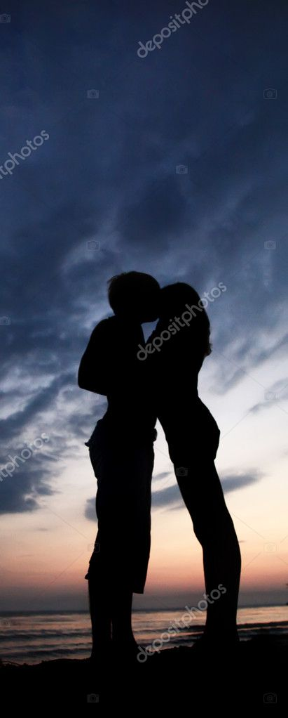 Two kissing at sunset  — Stock Photo #3581797