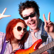Fashion boy and girl with guitar whow OK — Stock Photo