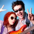 Stock Photo: Fashion boy and girl with guitar whow OK
