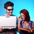 Stock Photo: Girl with old book and boy with notebook
