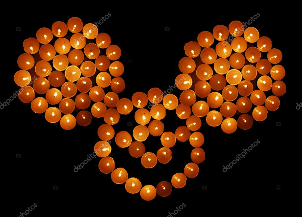 Candles placed in three circles an smile. — Stock Photo #3593126