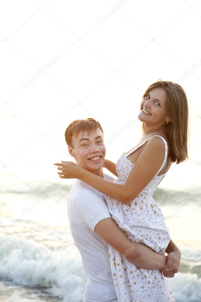 Closeup portrait of happy couple enjoying vacations on the beach   Stock Photo #3658911