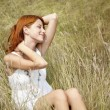 Beautiful red-haired girl at grass — Stock Photo #3662721