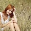 Beautiful red-haired girl at grass — Stock Photo #3662722