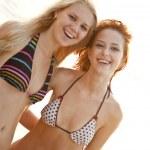 Two beautiful young girlfriends in bikini on the beach — Stock Photo #3676694
