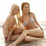 Two beautiful young girlfriends in bikini on the beach — Stock Photo #3676722