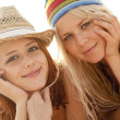 Two beautiful young girlfriends in bikini on the beach — Stok Fotoğraf #3676796