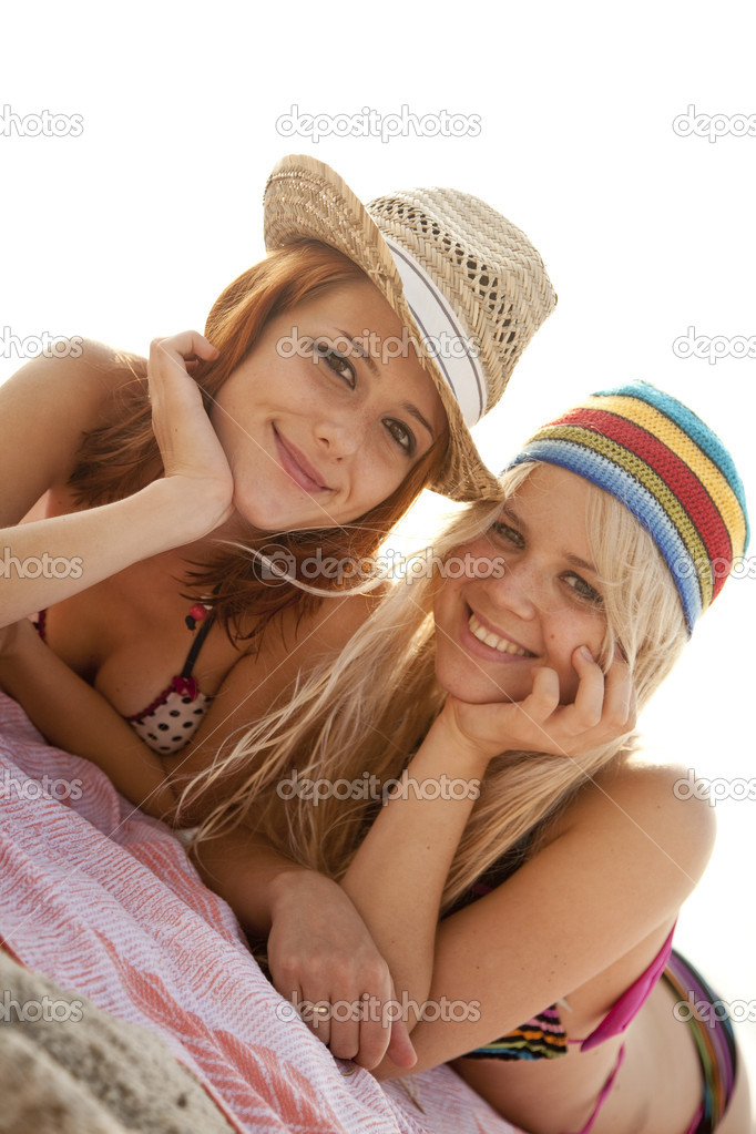 Two beautiful young girlfriends in bikini on the beach of Black Sea.Sunlight is on background. — Stock Photo #3676802